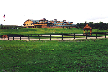 Horse farm in Bay Harbor, Michigan, with fences designed and installed by Proulx Fencing.